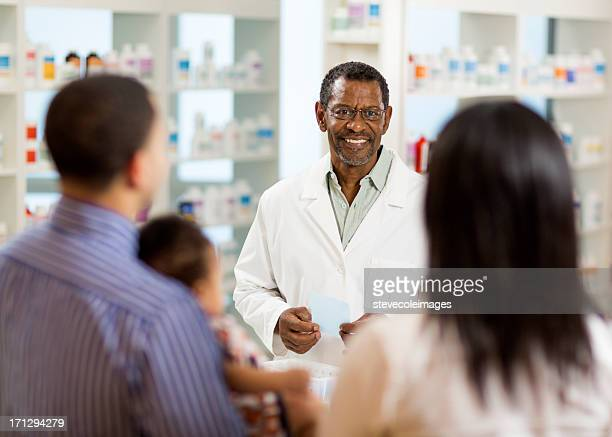 Pharmacist Talking to Young Family