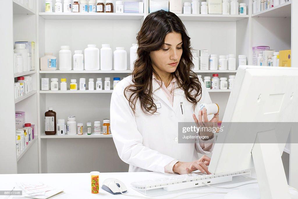 Pharmacist using computer : Stock Photo