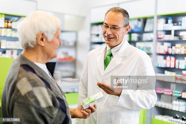 Pharmacist with a customer.