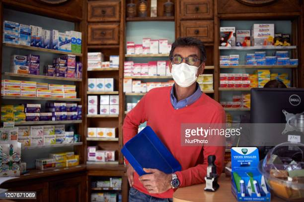 A pharmacist with a face mak poses for a portrait in Toulouse France on March 19 2020 For the 3rd day French people are on lockdown Since March 16t...