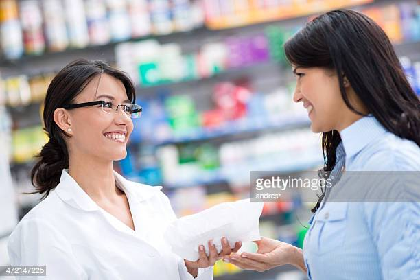 Pharmacist with client at a drugstore