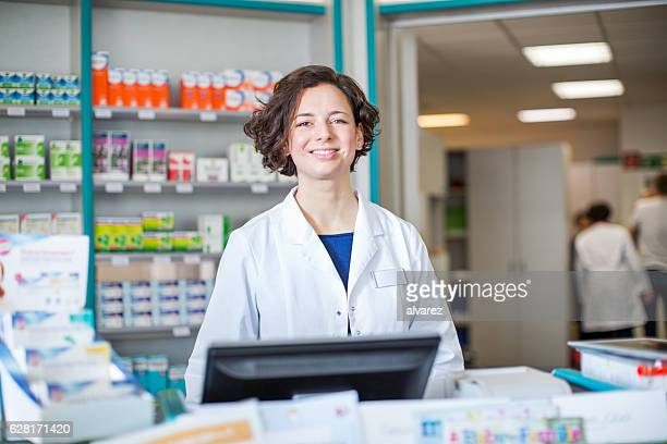Pharmacist working at cashier checkout counter