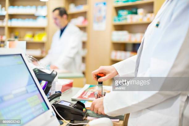 Pharmacist working at checkout counter