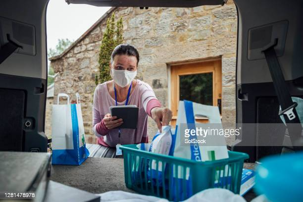 pharmacist working hard - uk stock pictures, royalty-free photos & images