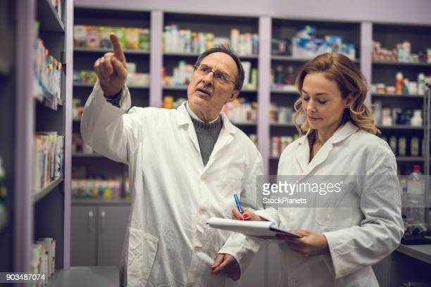 pharmacists at the pharmacy - homeopathic medicine stock photos and pictures