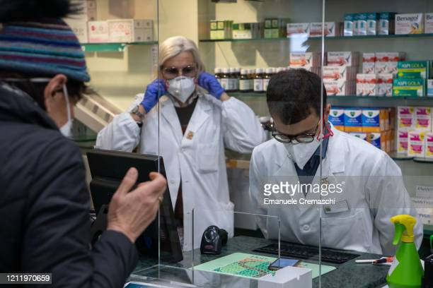 Pharmacists at work on March 11 2020 in Milan Italy The Italian Government has strengthened up its quarantine rules shutting all commercial...