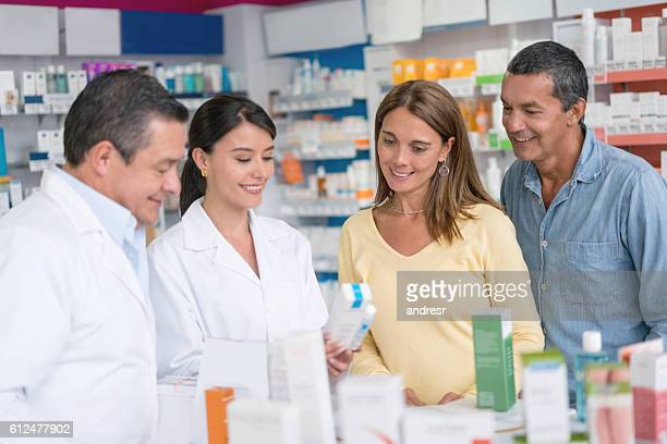 Pharmacists helping clients at the pharmacy