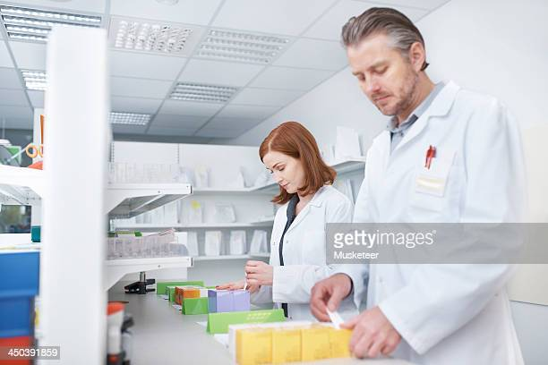 Pharmacists labelling drugs
