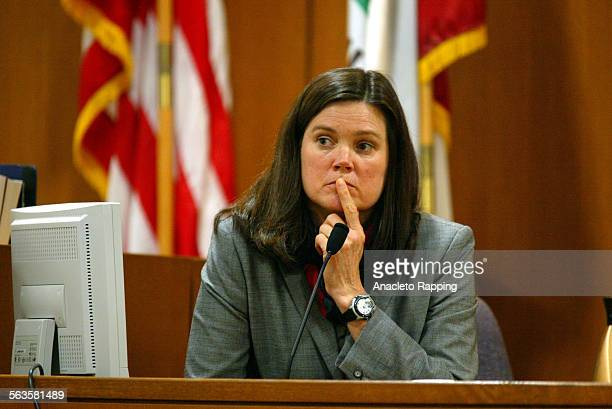 Pharmacologist Jo Dyer listens to a question while testifing for the prosecution about the date rape drug gamma hydroxybutyrate or GHB during trial...