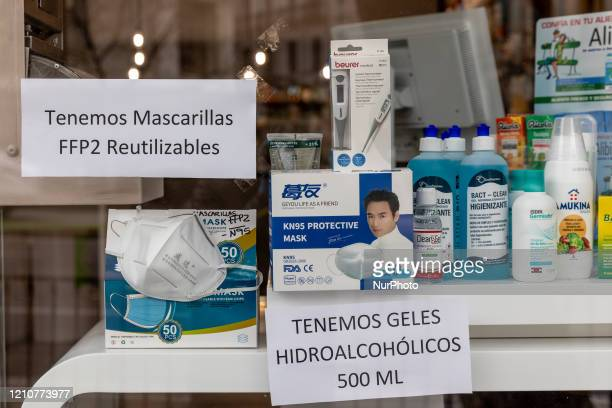 A pharmacy announces that it has sanitary masks and hydroalcohol for sale on April 21 2020 in Madrid Spain