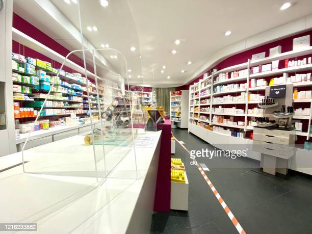 pharmacy cashier desks with acrylic glass panels - coronavirus protection stock pictures, royalty-free photos & images