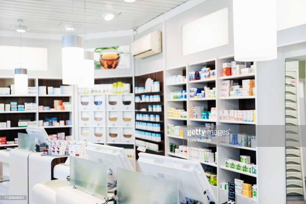 A Pharmacy Counter With Medicine On Display : Stock Photo