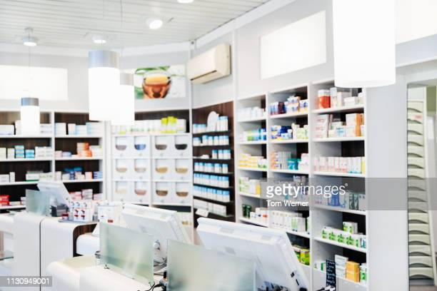 a pharmacy counter with medicine on display - medical supplies stock pictures, royalty-free photos & images
