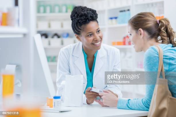 Pharmacy customer asks pharmacist question about medication