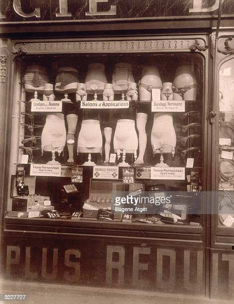 Pharmacy display window featuring mannequin torsos and legs wearing girdles and tensor bandages on the 'Boulevard de Strasbourg' Paris France...