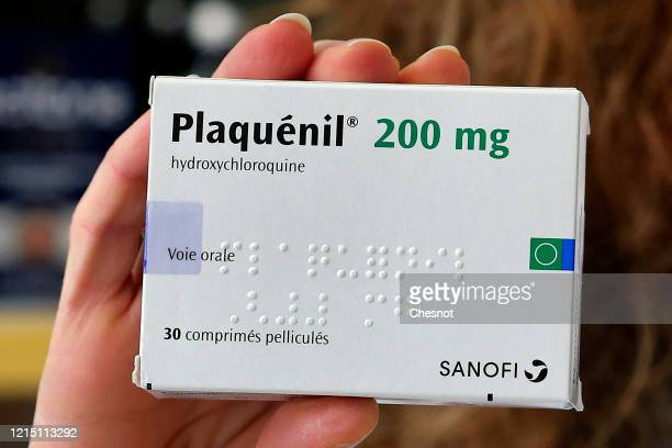 A pharmacy employee shows a box of Plaquenil on March 27 2020 in Paris France French Minister of Health Olivier Veran in a decree published in the...
