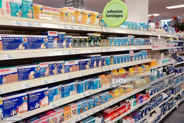 Pharmacy, First aid aisle, adhesive bandages.