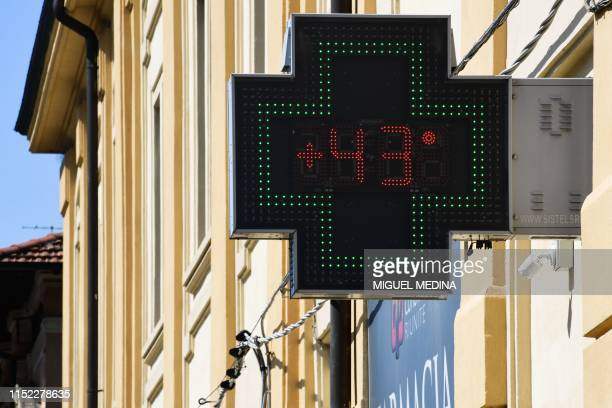 Pharmacy sign displays a temperature of 43 degrees Celsius on June 27, 2019 in Reggio Emilia, near Bologna, northern Italy. - Europeans braced on...