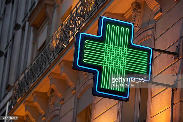 Pharmacy sign in Paris, France
