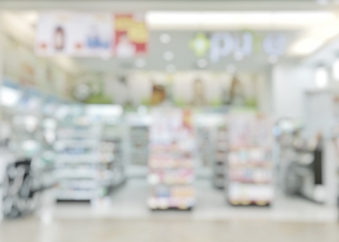 Pharmacy store or drugstore blur background with drug shelf and blurry pharmaceutical products, cosmetic and medication supplies on shelves inside retail shop interior 1026273192