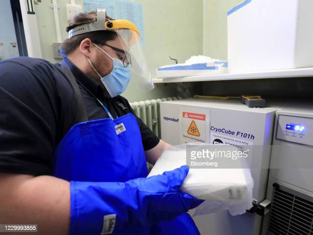 Pharmacy technician from Croydon Health Services takes delivery of Covid-19 vaccine shots, developed by Pfizer Inc.AndBioNTech SE, at Croydon...