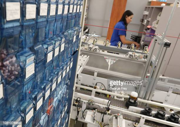 A pharmacy technician prepares prescriptions for packaging and shipping after being filled on an automated line at the central pharmacy of...