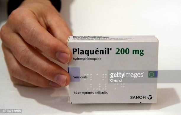A pharmacy worker shows a box of Plaquenil on March 25 2020 in Paris France The hydroxychloroquine marketed under the name of Plaquenil is now one of...