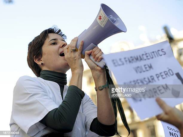 A pharmacy worker takes part on November 7 2013 in Barcelona in a demonstrationagainst the nonpayment of bills for pharmacies by the Spanish...