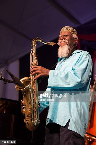 Pharoah Sanders performs at the Fairgrounds Race Course during the New Orleans Jazz And Heritage Festival on May 2 2014 in New Orleans Louisiana