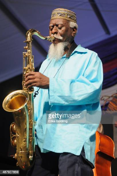 Pharoah Sanders performs during the 2014 New Orleans Jazz Heritage Festival at Fair Grounds Race Course on May 2 2014 in New Orleans Louisiana