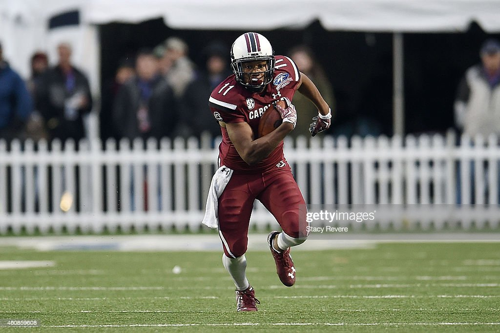 Pharoh Cooper #11 of the South Carolina Gamecocks runs for yards against the Miami Hurricanes during the third quarter of the Duck Commander Independence Bowl at Independence Stadium on December 27, 2014 in Shreveport, Louisiana.