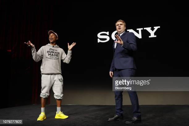 Pharrell Williams a singer and performer left and Rob Stringer chief executive officer of Sony Music Entertainment speak during the Sony Electronics...