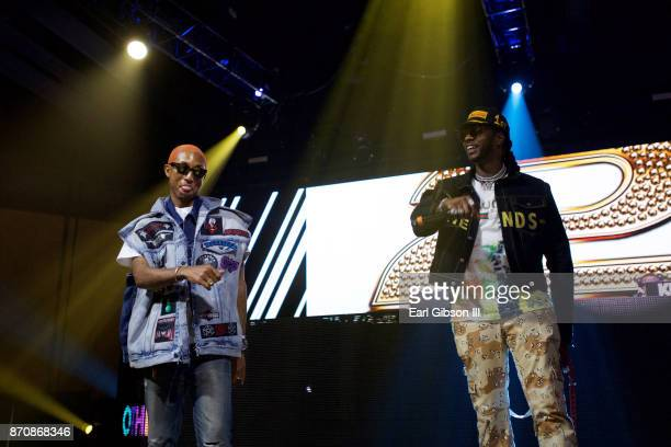 Pharrell Williams and 2 Chainz perform at ComplexCon 2017 on November 5 2017 in Long Beach California