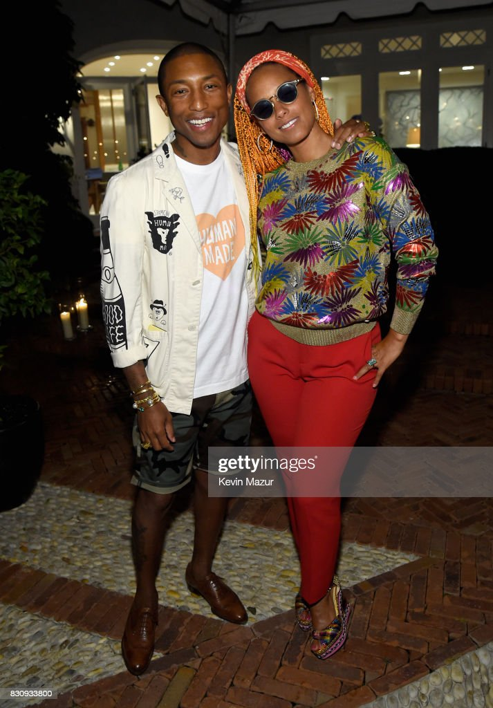 Pharrell Williams and Alicia Keys attend Apollo in the Hamptons 2017: hosted by Ronald O. Perelman at The Creeks on August 12, 2017 in East Hampton, New York.