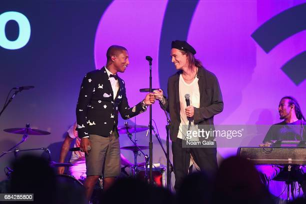 Pharrell Williams and Brandon Boyd of Incubus perform onstage during TechCrunch Disrupt NY 2017 Day 3 at Pier 36 on May 17 2017 in New York City