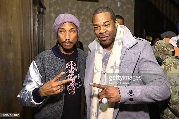 Pharrell Williams and Busta Rhymes celebrate the release of his new book 'Pharrell Spaces And Places I've Been' at the Arlington Club on November 7...