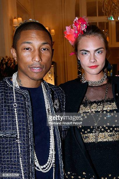 Pharrell Williams and Cara Delevingne attend the 'Chanel Collection des Metiers d'Art 2016/17 Paris Cosmopolite' Show at Hotel Ritz on December 6...