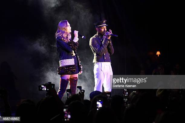 Pharrell Williams and Cara Delevingne perform onstage during the CHANEL ParisSalzburg 2014/15 Metiers d'Art Collection in New York City at the Park...