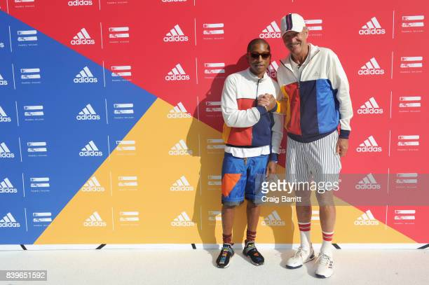 Pharrell Williams and designer Stan Smith attend adidas Tennis Pharrell Williams Don't Be Quiet Please Event at Frederick Johnson Tennis Courts on...