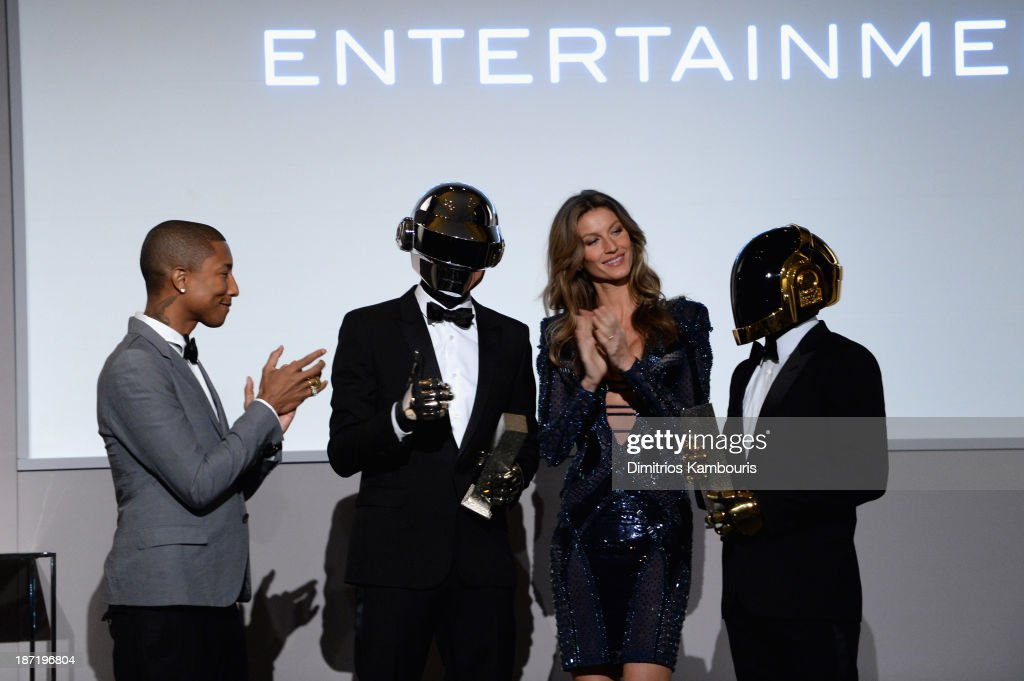 Pharrell Williams and Gisele Bündchen present an award to Daft Punk onstage at the WSJ. Magazine's 'Innovator Of The Year' Awards 2013 at The Museum of Modern Art on November 6, 2013 in New York City.