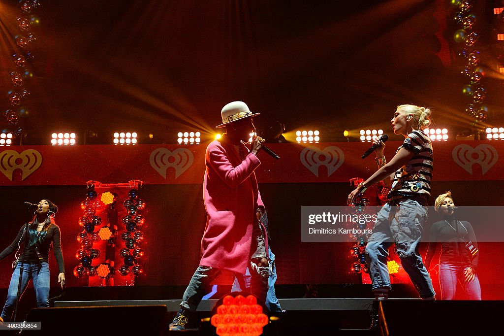 Pharrell Williams (L) and Gwen Stefani perform onstage during iHeartRadio Jingle Ball 2014, hosted by Z100 New York and presented by Goldfish Puffs at Madison Square Garden on December 12, 2014 in New York City.