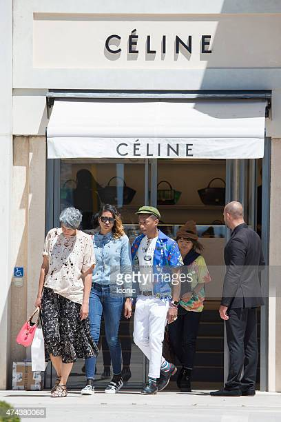 Pharrell Williams and Helen Lasichanh are seen enjoying a shopping day during the 68th Annual Cannes Film Festival on May 22 2015 in Cannes France