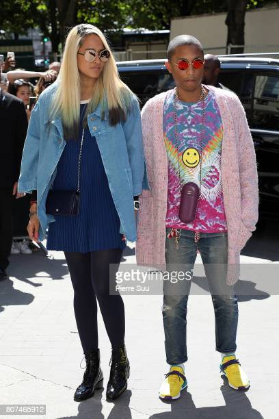 Pharrell Williams and Helen Lasichanh arrive at the Chanel Haute Couture Fall/Winter 20172018 show as part of Haute Couture Paris Fashion Week on...