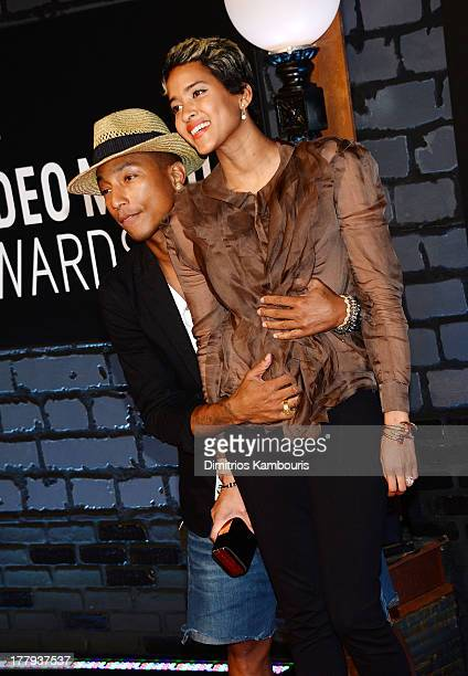 Pharrell Williams and Helen Lasichanh attend the 2013 MTV Video Music Awards at the Barclays Center on August 25 2013 in the Brooklyn borough of New...