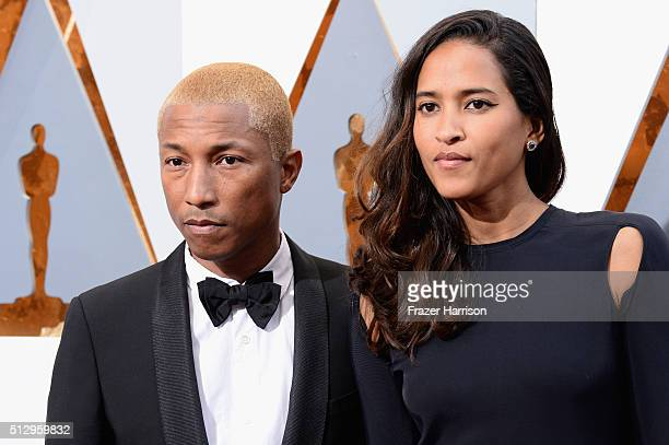 Pharrell Williams and Helen Lasichanh attend the 88th Annual Academy Awards at Hollywood Highland Center on February 28 2016 in Hollywood California