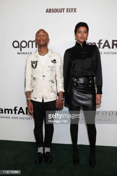 Pharrell Williams and Helen Lasichanh attend the amfAR Gala Hong Kong 2019 at the Rosewood Hong Kong on March 25 2019 in Hong Kong Hong Kong