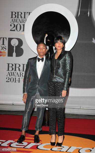 Pharrell Williams and Helen Lasichanh attend The BRIT Awards 2014 at 02 Arena on February 19 2014 in London England
