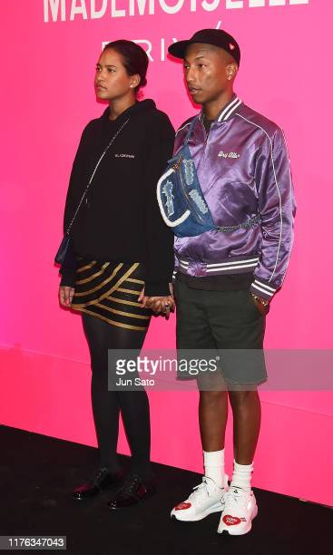 Pharrell Williams and Helen Lasichanh attend the Chanel Mademoiselle Prive Tokyo on October 17 2019 in Tokyo Japan