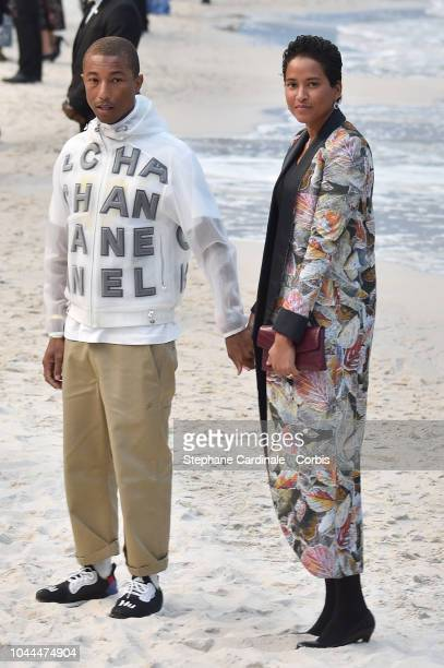 Pharrell Williams and Helen Lasichanh attend the Chanel show as part of the Paris Fashion Week Womenswear Spring/Summer 2019 on October 2 2018 in...