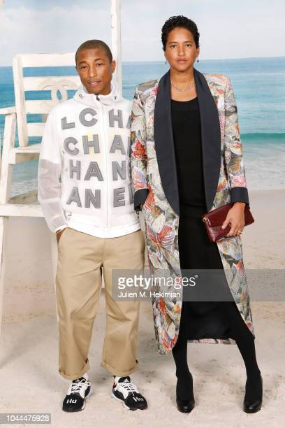 Pharrell Williams and Helen Lasichanh attend the Chanel show at Le Grand Palais as part of Paris Fashion Week Womenswear on October 2 2018 in Paris...